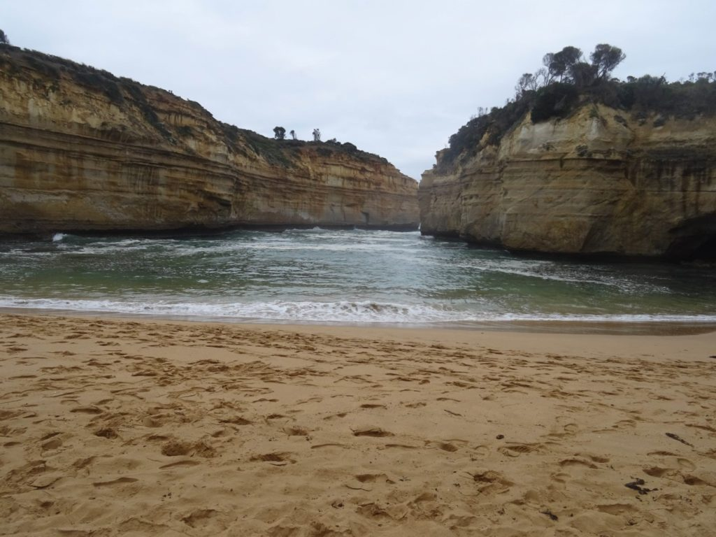 The sandy beach at the bottom of Loch Ard Gorge