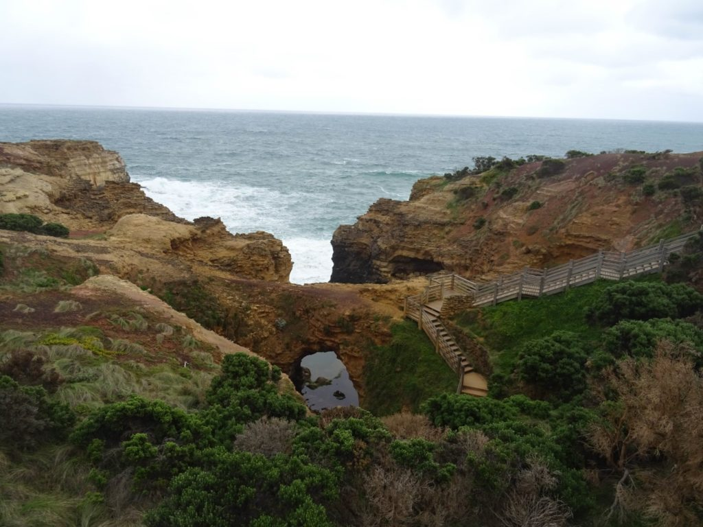 The view of the Grotto from the carpark, showing the stairs that lead down the cliff to the grotto itself