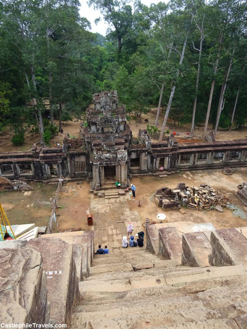 Looking over the entrance to Ta Keo temple and taking in the view from the top of the second flight of stairs