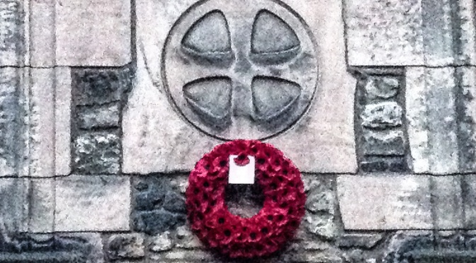 A wreath of poppies on the wall of the National War Memorial of Scotland