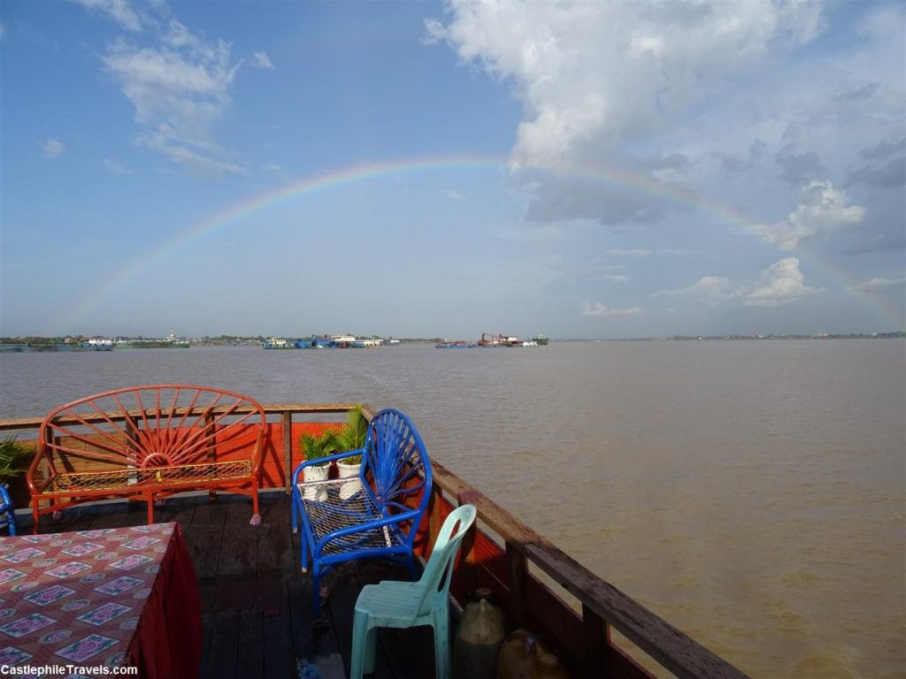 Admiring the double rainbow from the back of the boat