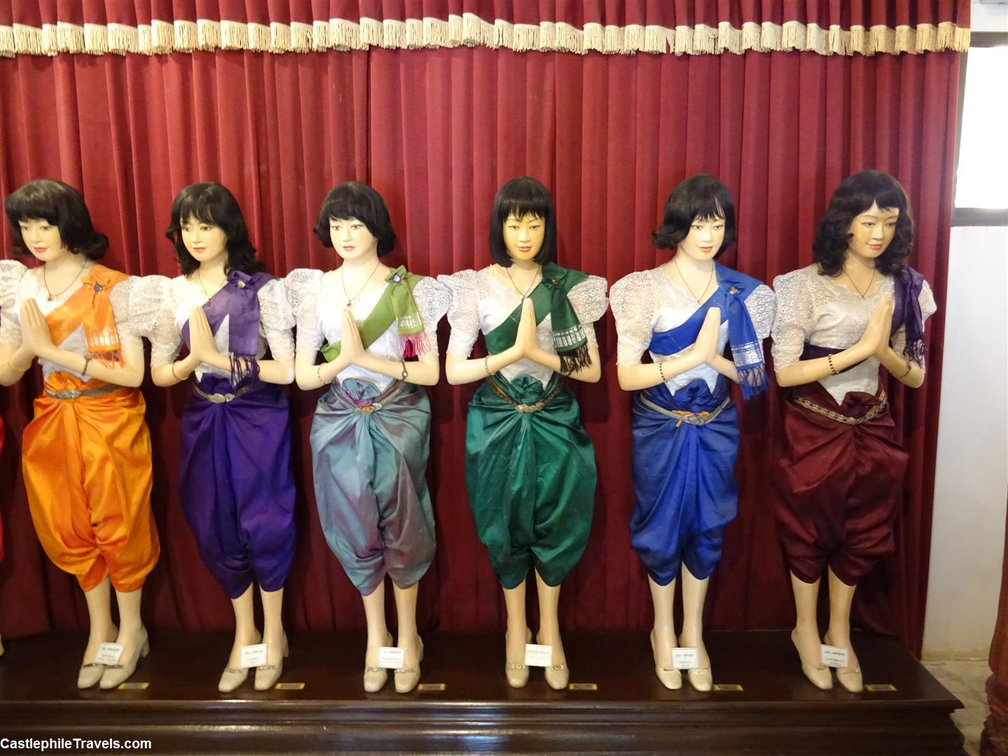 Mannequins inside the Hor Samritvimean wearing colourful costumes labelled as the days of the week.