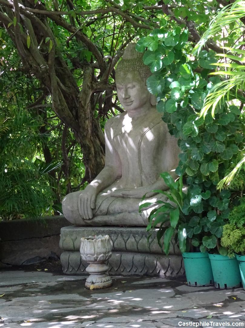 A statue of Buddha in the gardens of 'Kailassa Mountain'.